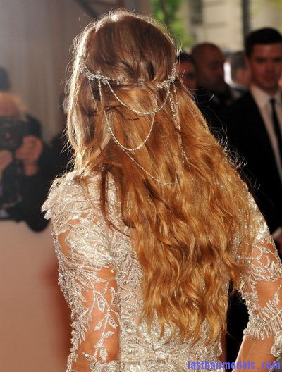 Cascading loose hairstyles loose waves topped with a bohemian crown of chains Hair chains!!: A new thing to experiment with!