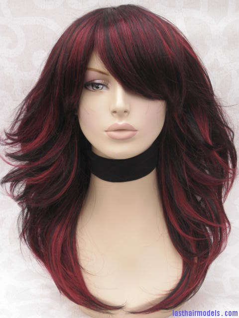The red and black combo in styling hair perfect pick for the get a long razor cut and color the hair in thin streaks of dull red and black as the wig on the mannequin your oomph factor is sure to rise urmus Choice Image