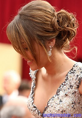 Miley Cyrus Casual Prom Updo Hairstyles Miley Cyruss bun with bangs: Hairstyle for an evening bonanza!