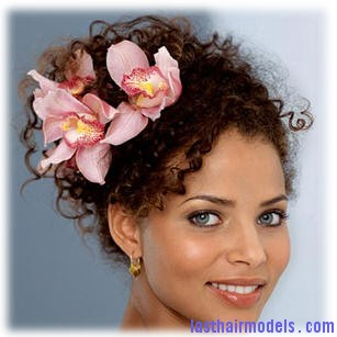 messy high plait deeply perm curly hair up do black wedding hairstyle pink lily flowers Wedding on the row: different wedding hairstyles.