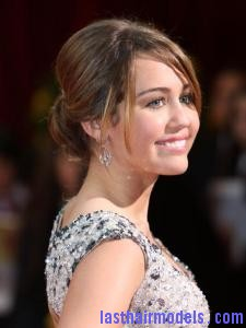 miley cyrus simple bun hairstyle186 Miley Cyruss bun with bangs: Hairstyle for an evening bonanza!