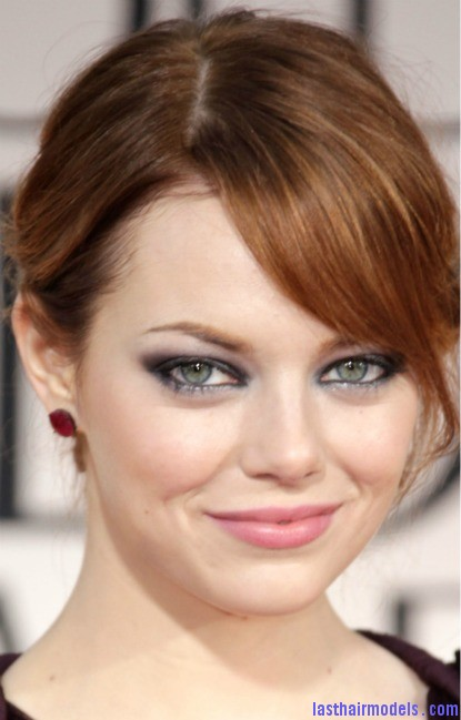 Emma Stone S Bun With Side Bangs The Sleeky Messy Combo Look