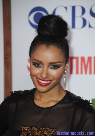 120297010 xxlarge Kat Grahams afro hair top knot in style.