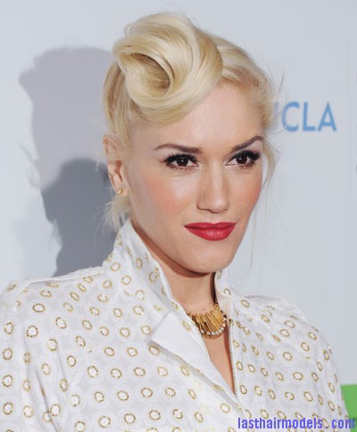 1209 gwen stefani hair hair french twist front bd Gwen Stephani's lopsided side retro roll.