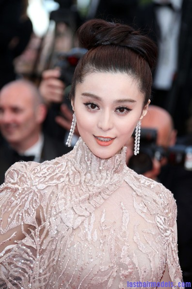 Fan+Bingbing+Stars+Rust+Bone+Premiere+Cannes+BBlxxJgGkqgl Fan Bing Bing's bow shaped updo: Combining moderancy with tradition.