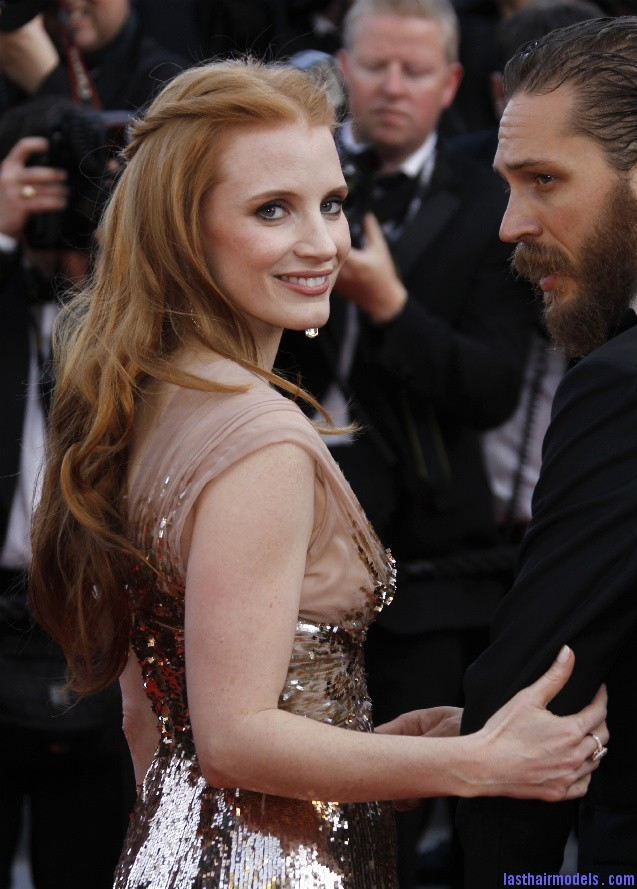 Jessica Chastain smiles for the cameras Jessica Chastain's twisted half tie.