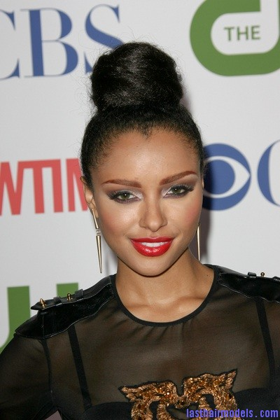 KatGraham Kat Grahams afro hair top knot in style.