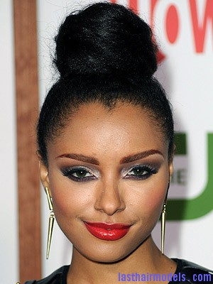 Kat Graham+August 03 2011 Kat Grahams afro hair top knot in style.