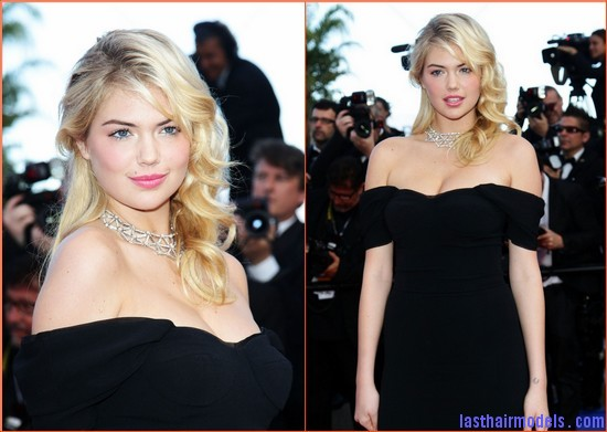 Kate Upton at Cannes in black Kate Upton's messy round curls.