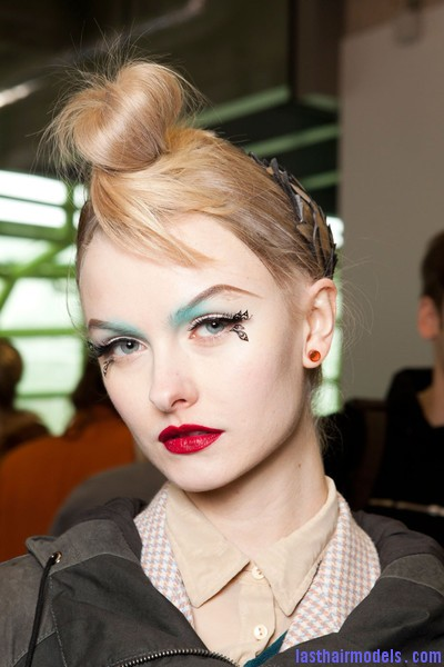 Manish+Arora+Fall+2012+Backstage+9bay CHV3vdl Hairstyle at Manish Arora 2012 fall: Twisted top knots with metal leaf accessories.