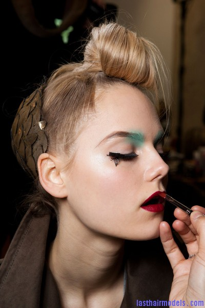 Manish+Arora+Fall+2012+Backstage+nxMiZwCptQvl Hairstyle at Manish Arora 2012 fall: Twisted top knots with metal leaf accessories.
