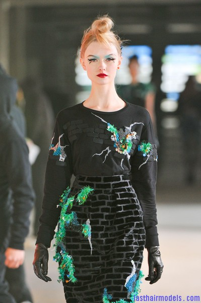 Manish+Arora+Fall+2012+c10IS0Ccwvwl Hairstyle at Manish Arora 2012 fall: Twisted top knots with metal leaf accessories.