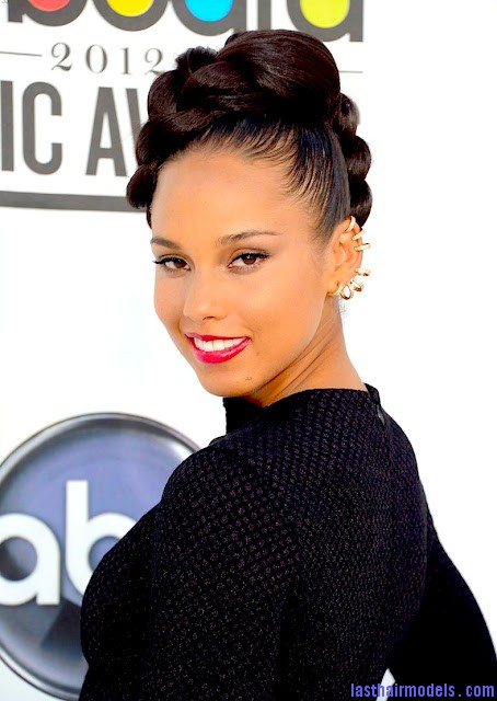 Alicia keys thick plaited updo.