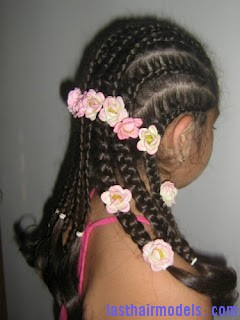 plaitsandflowers Multiple hair plaits and braids hairstyle.