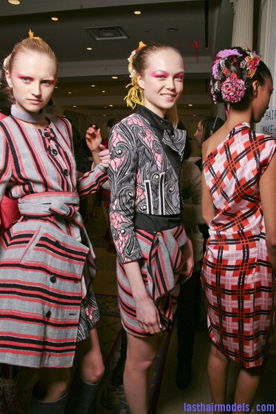 Thakoon+Fall+2011+Backstage+FhFziED fqGl Chinese inspired woolen hair accessorized buns.