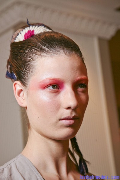 Thakoon+Fall+2011+Backstage+je4I6qcxVkgl Chinese inspired woolen hair accessorized buns.