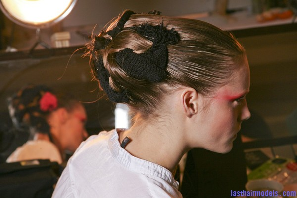Thakoon+Fall+2011+Backstage+x2rbVyb0sBql Chinese inspired woolen hair accessorized buns.