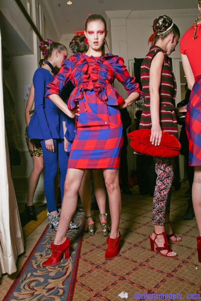 Thakoon+Fall+2011+Backstage+zaMpFG5ntgrl Chinese inspired woolen hair accessorized buns.