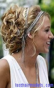 Grecian updo last hair models hair styles last hair models to create a grecian updo first set the hair with hot rollers and leave it to cool naturally remove the curler gently and then mist all over the hair with pmusecretfo Image collections
