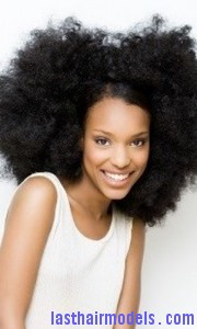 Happy girl with big afro hair.
